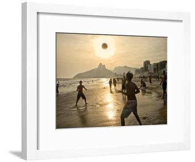 Young Men Play Beach Football on Ipanema Beach as the Sun Sets-Kike Calvo-Framed Photographic Print