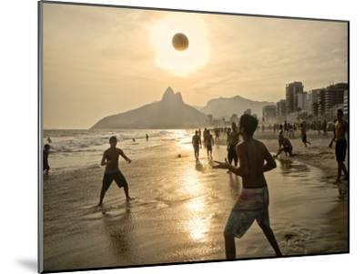 Young Men Play Beach Football on Ipanema Beach as the Sun Sets-Kike Calvo-Mounted Photographic Print