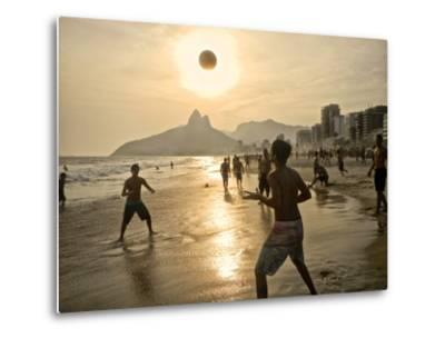 Young Men Play Beach Football on Ipanema Beach as the Sun Sets-Kike Calvo-Metal Print