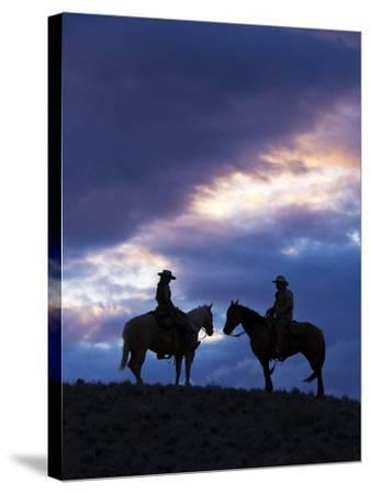Cowboys in Silouette with Sunset-Terry Eggers-Stretched Canvas Print
