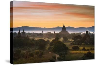 Sunset over Bagan-Jon Hicks-Stretched Canvas Print