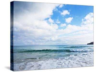 Cloudy Sky over Sea with Some Waves-Norbert Schaefer-Stretched Canvas Print