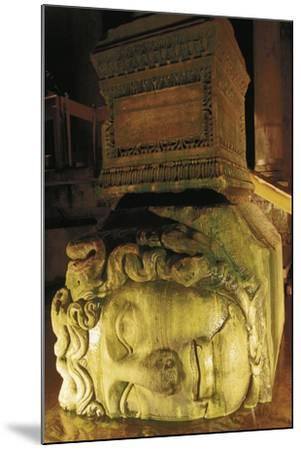 Colossal Head of Medusa Used as the Base of a Column in the Basilica Cistern--Mounted Photographic Print