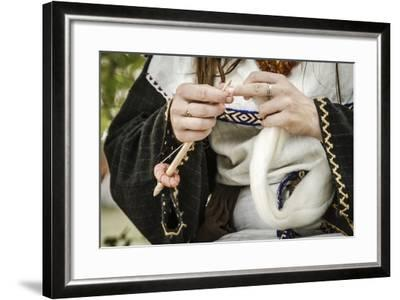 Historical Reenactment: Woman Spinning Wool in Gallic Village--Framed Photographic Print