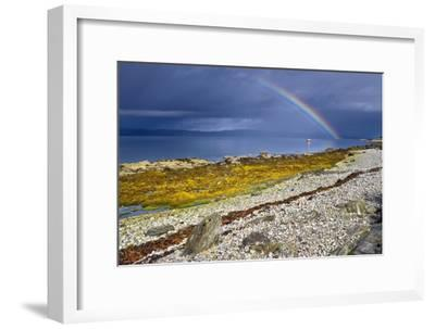 Rainbow Above Rocky Beach and Small Boat--Framed Photographic Print