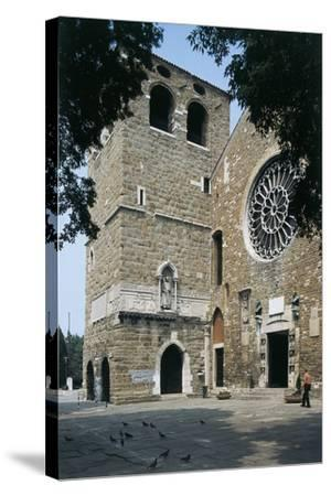 Side Profile of a Senior Man Walking in Front of a Basilica--Stretched Canvas Print