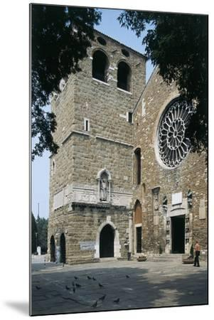 Side Profile of a Senior Man Walking in Front of a Basilica--Mounted Photographic Print