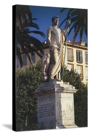 Statue on a Pedestal in Front of a Building--Stretched Canvas Print