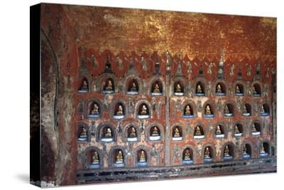 Wood Panel with Niches Containing Statues of Buddha--Stretched Canvas Print