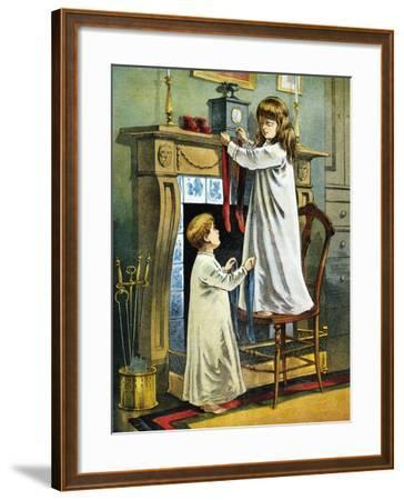 Boy and Girl Place Stockings on their Fireplace Mantle on Christmas Eve, 1918--Framed Giclee Print