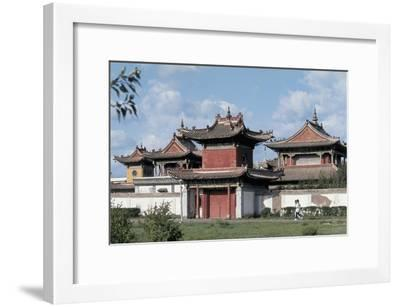 Side Profile of Two People Jogging in Front of a Building, Ulan Bator, Mongolia--Framed Giclee Print