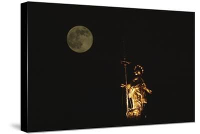 Madonnina Atop the Cathedral of Milan, Nighttime with Full Moon, Lombardy, Italy--Stretched Canvas Print