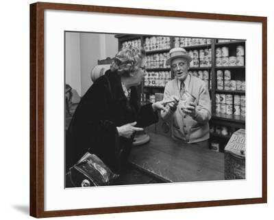 A Replica of an Early General Store Depicting a Salesman with a Can of Pears in Hand as He Tells a --Framed Photographic Print