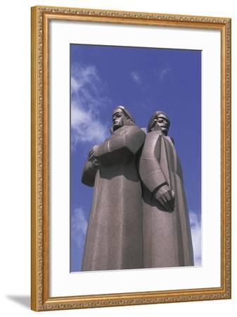 Low Angle View of Two Statues, Red Latvian Riflemen, Riga, Latvia Giclee  Print by | Art com