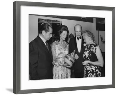 A Group of Distinguished Guests Viewing Traditional Mexican Pottery--Framed Photographic Print