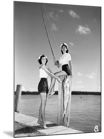 Toby Gerard and Barbara Wartell Strike Fishy Poses, April 1951--Mounted Photographic Print