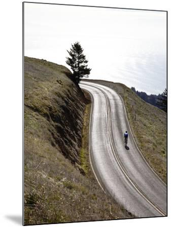 A Bicyclist Riding in Mount Tamalpais State Park, with the Pacific Ocean in the Distance-Keith Barraclough-Mounted Photographic Print