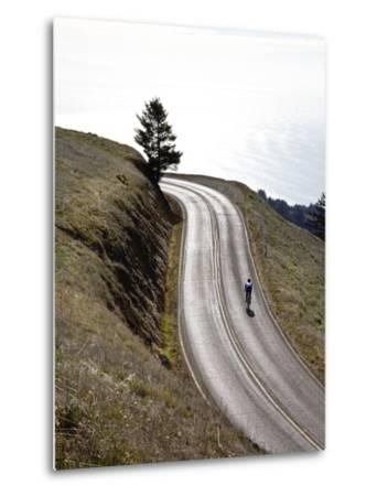 A Bicyclist Riding in Mount Tamalpais State Park, with the Pacific Ocean in the Distance-Keith Barraclough-Metal Print