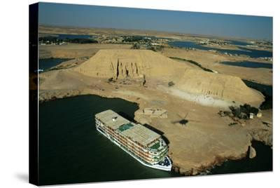 A Cruise Ship on Lake Nasser Near the Great Temple of Abu Simbel-Marcello Bertinetti-Stretched Canvas Print