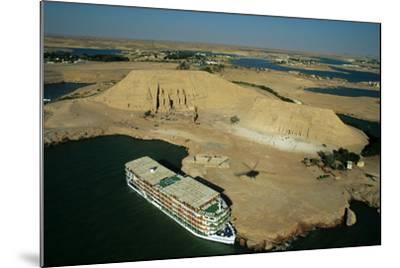 A Cruise Ship on Lake Nasser Near the Great Temple of Abu Simbel-Marcello Bertinetti-Mounted Photographic Print