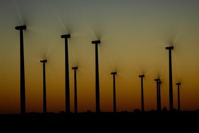 Silhouettes of a Windmills on a Wind Farm-Michael Forsberg-Framed Photographic Print