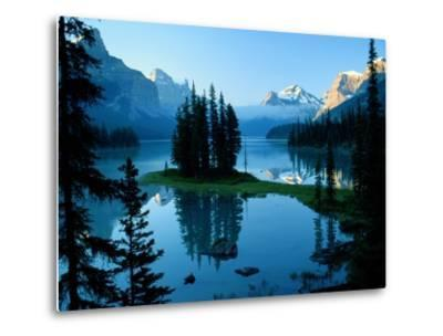 Scenic View of the Lake Surrounded by Evergreens and Snow-Capped Mountains-Raymond Gehman-Metal Print
