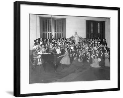 Group Portrait of a Girls' Chorus Class Gathered around a Piano Holding Sheet Music-William Davis Hassler-Framed Photographic Print