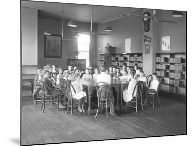 Children Listen to a Woman in the Reading Room-William Davis Hassler-Mounted Photographic Print