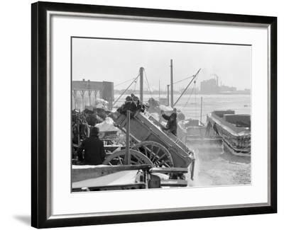 Dumping Snow into the River after a Blizzard, New York--Framed Photo