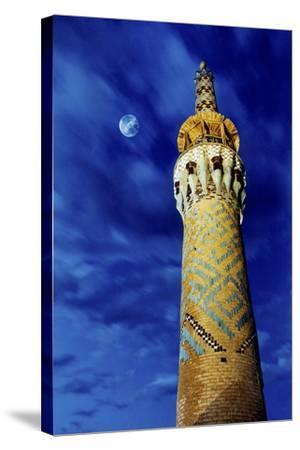 The Moon in the Evening Sky Above the Historic Minaret of Tekeye Mirchaqmaq, in Yazd, Iran-Babak Tafreshi-Stretched Canvas Print