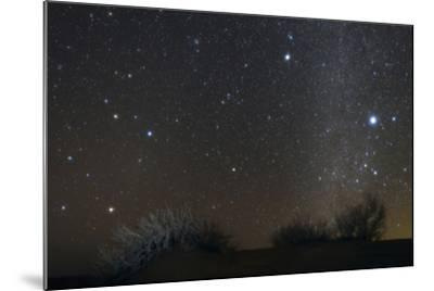 Constellations Leo and Hydra; the Milky Way; Saturn; Bright Stars Sirius and Procyon, over Desert-Babak Tafreshi-Mounted Photographic Print