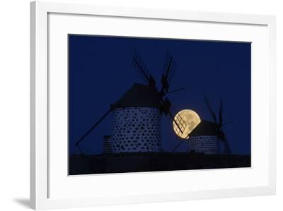 The Full Moon, a Wolf Moon, First Full Moon after the Winter Solstice, at Dawn Behind Windmills-Babak Tafreshi-Framed Photographic Print