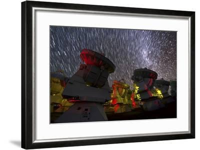 A Time-Exposure Image of Star Trails over the Alma Radio Telescopes, 5000 Meters High in the Andes-Babak Tafreshi-Framed Photographic Print