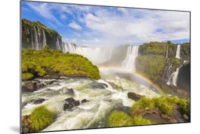 A Rainbow at Iguazu Waterfalls on the Border of Argentina and Brazil in South America-Mike Theiss-Mounted Photographic Print