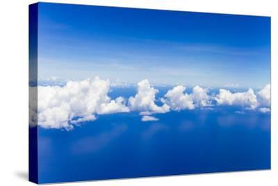 Cumulus Clouds Floating Above Flat Calm Seas on the Atlantic Ocean, Somewhere Near the Bahamas-Mike Theiss-Stretched Canvas Print
