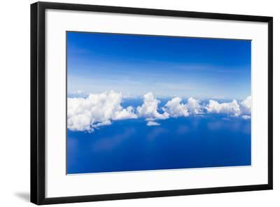 Cumulus Clouds Floating Above Flat Calm Seas on the Atlantic Ocean, Somewhere Near the Bahamas-Mike Theiss-Framed Photographic Print