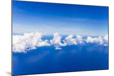 Cumulus Clouds Floating Above Flat Calm Seas on the Atlantic Ocean, Somewhere Near the Bahamas-Mike Theiss-Mounted Photographic Print