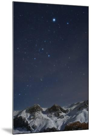 Sirius, and the Rest of Constellation Canis Major Above Snow-Covered Peaks of the Alborz Mountains-Babak Tafreshi-Mounted Photographic Print