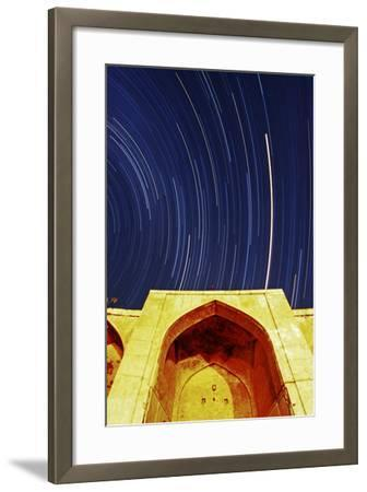 A Time-Exposure of Star Trails Above a Historic Caravansary. the Brightest Trail Is Planet Mars-Babak Tafreshi-Framed Photographic Print
