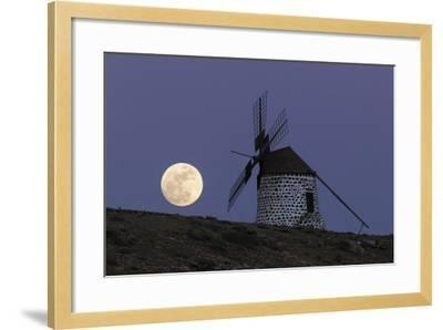 The Full Moon, and Wolf Moon, the First Full Moon after the Winter Solstice, over a Windmill-Babak Tafreshi-Framed Photographic Print