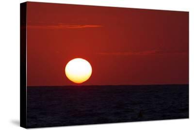 The Sun Sinks into the Atlantic Ocean, Off the Coast of Normandy, France-Babak Tafreshi-Stretched Canvas Print