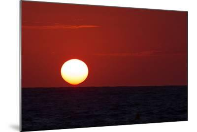 The Sun Sinks into the Atlantic Ocean, Off the Coast of Normandy, France-Babak Tafreshi-Mounted Photographic Print