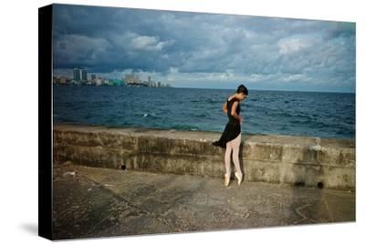 A Ballerina from the National Ballet of Cuba Dances En Pointe on Havana's Malecon-Kike Calvo-Stretched Canvas Print