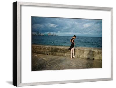 A Ballerina from the National Ballet of Cuba Dances En Pointe on Havana's Malecon-Kike Calvo-Framed Premium Photographic Print