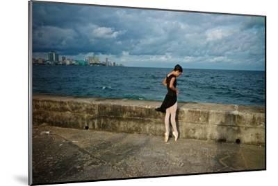 A Ballerina from the National Ballet of Cuba Dances En Pointe on Havana's Malecon-Kike Calvo-Mounted Premium Photographic Print