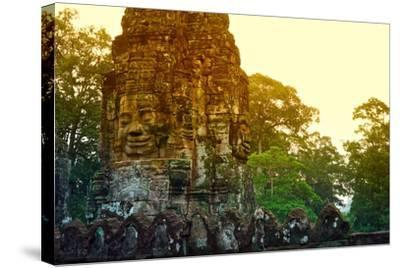 Stone Faces Carved in the Ancient Ruins of Bayon Temple-Kike Calvo-Stretched Canvas Print