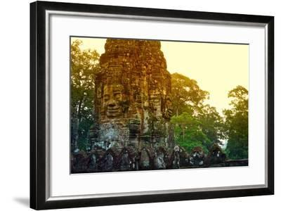 Stone Faces Carved in the Ancient Ruins of Bayon Temple-Kike Calvo-Framed Photographic Print