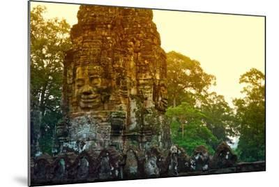 Stone Faces Carved in the Ancient Ruins of Bayon Temple-Kike Calvo-Mounted Photographic Print