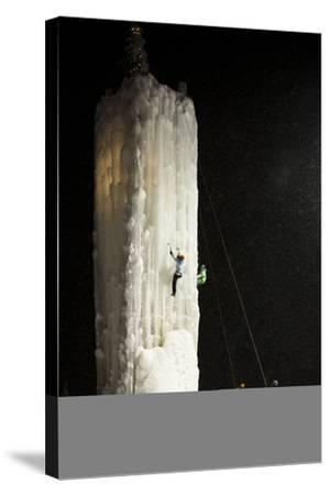 Two People Ice Climb a Tower at the Big White Ski Resort-Michael Hanson-Stretched Canvas Print