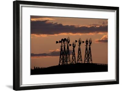 Silhouettes of Windmills Against the Sunset-Michael Forsberg-Framed Photographic Print